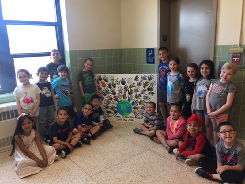Kramer Lane students give a hand for Earth Day