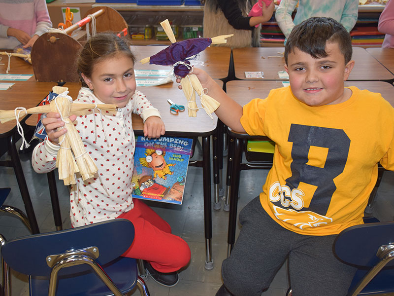Charles Campagne Students Construct Cornhusk Dolls